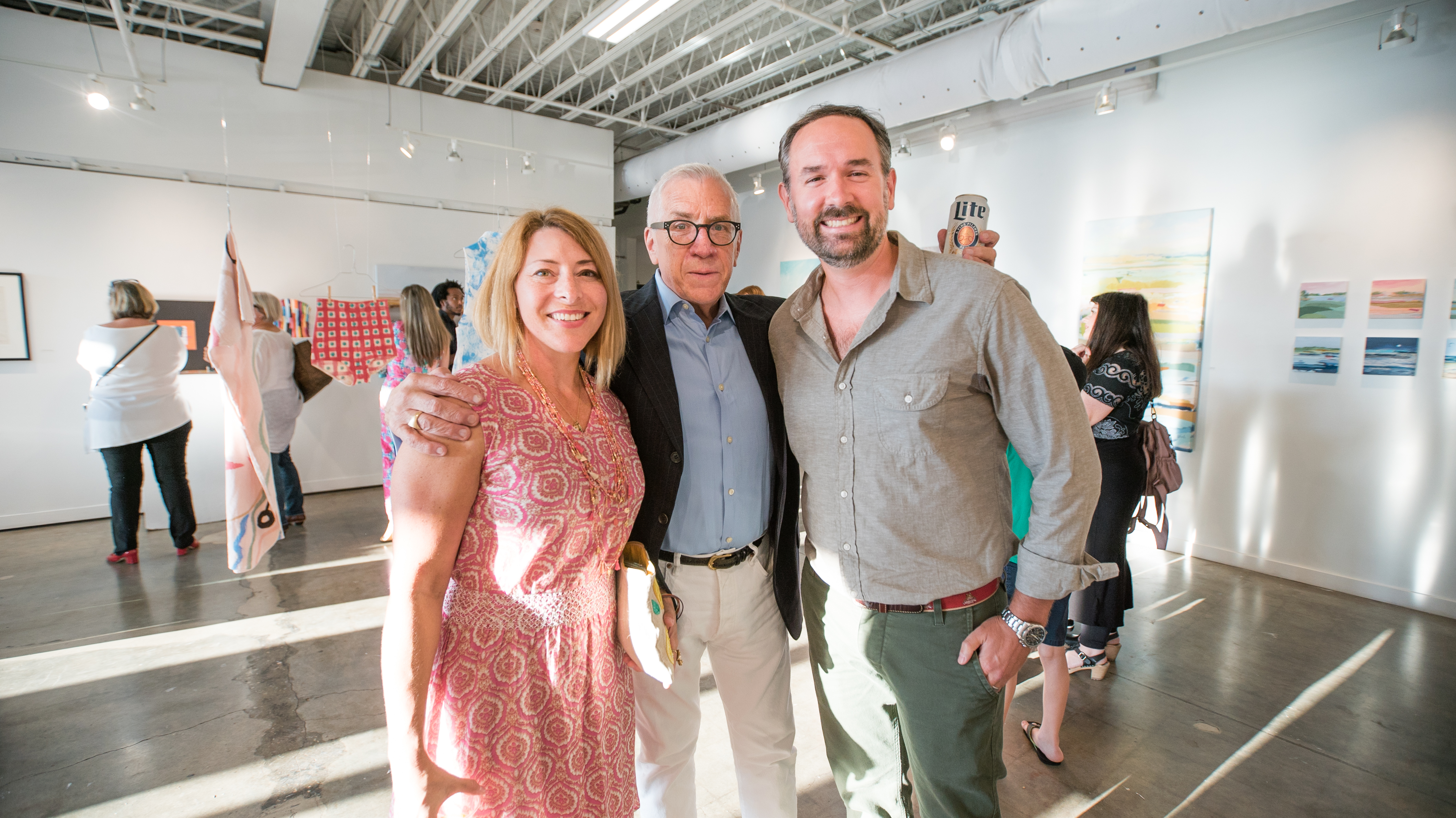 Curator Terry Fox of Charleston Arts Festival (center) with artists Karin Olah and Joel Parker