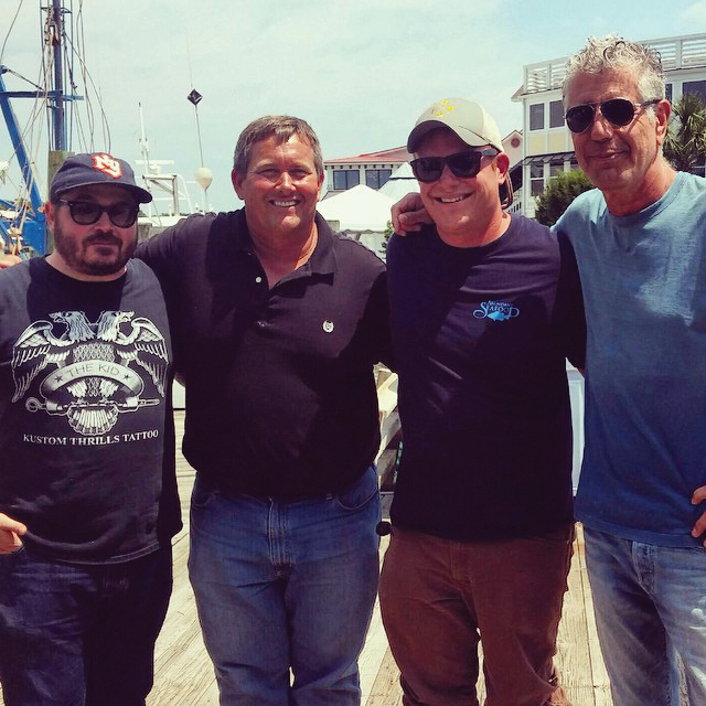 In 2015, Abundant Seafood was featured on the late Anthony Bourdain's Parts Unknown. Here, chef Sean Brock, Mark, chef Aaron Swersky and Bourdain pose at Geechie Dock.