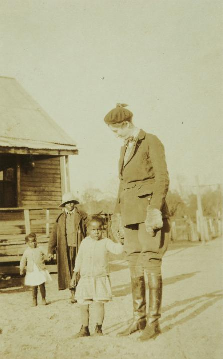 With students in Hobcaw's Strawberry Village, circa 1930