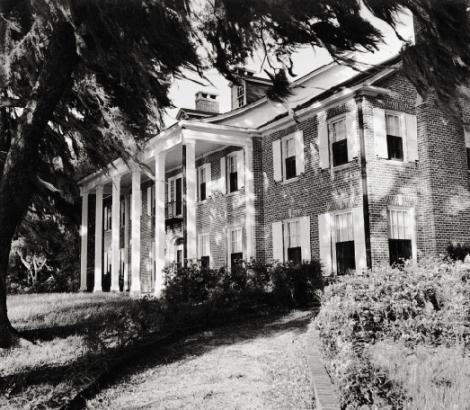 The family's stately brick Hobcaw House—which Bernard had rebuilt in 1929 after a fire destroyed the original wood home—on a bluff overlooking Winyah Bay