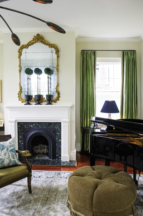 In the parlor, kiwi-green drapes reference Charleston's lush landscape.