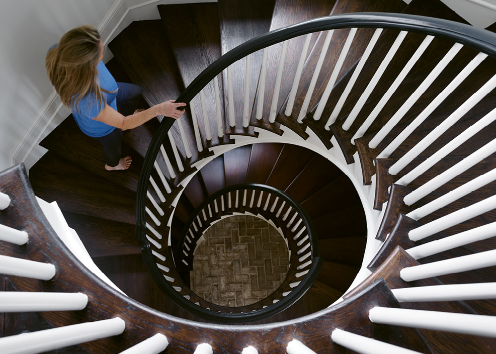 In the main residence, a circular staircase rises three stories to the family's private quarters.
