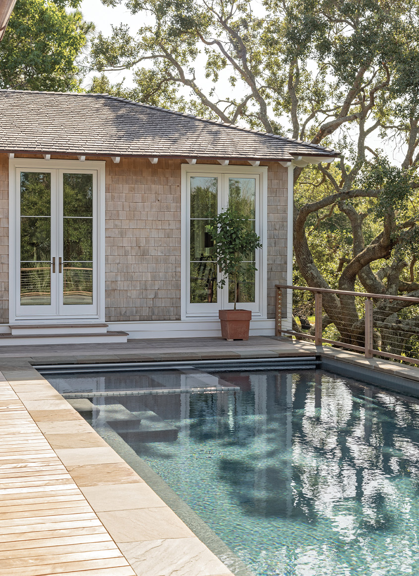 The back porch got a major upgrade, with the addition of a swimming pool just outside the homeowner's bedroom.