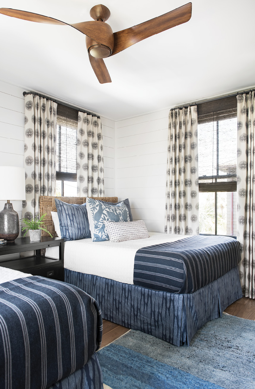 The large, double guest room is layered in blues, from the FAYCE Textiles bed skirts and shams to the ombré blue rug sourced in Morocco