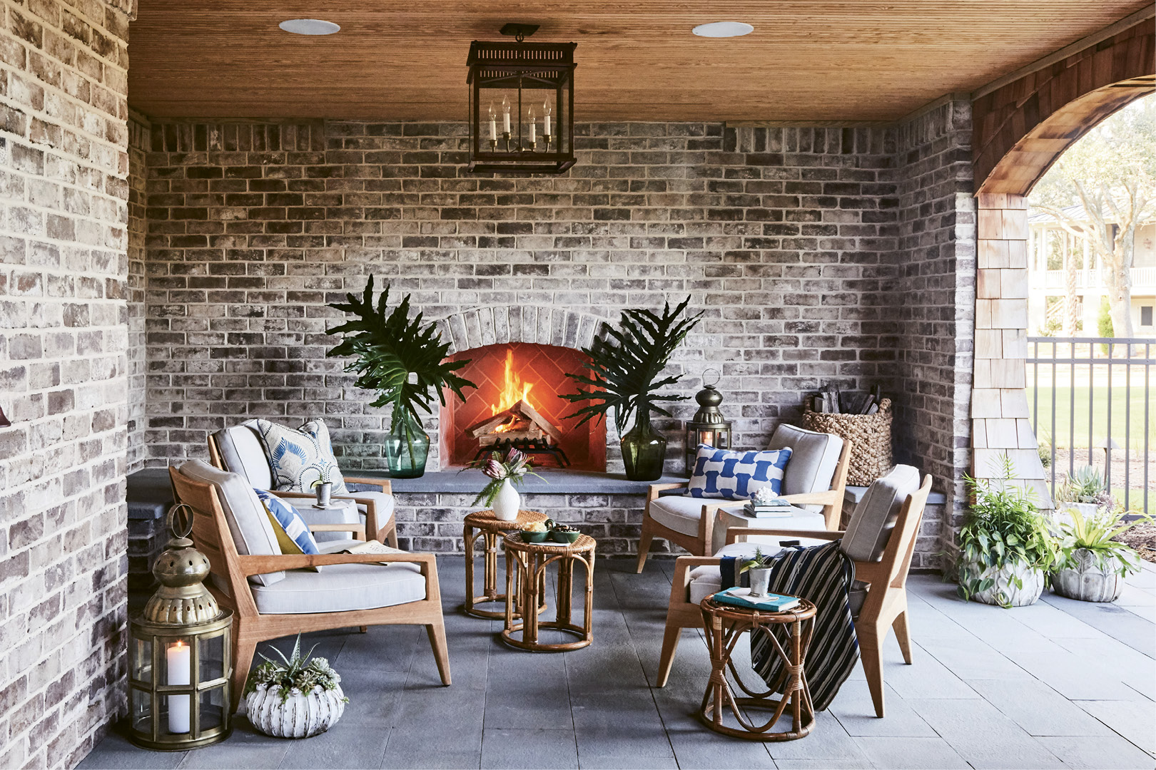 An outdoor living room, complete with fireplace (left), is a cozy entertaining spot, especially on cool winter nights.