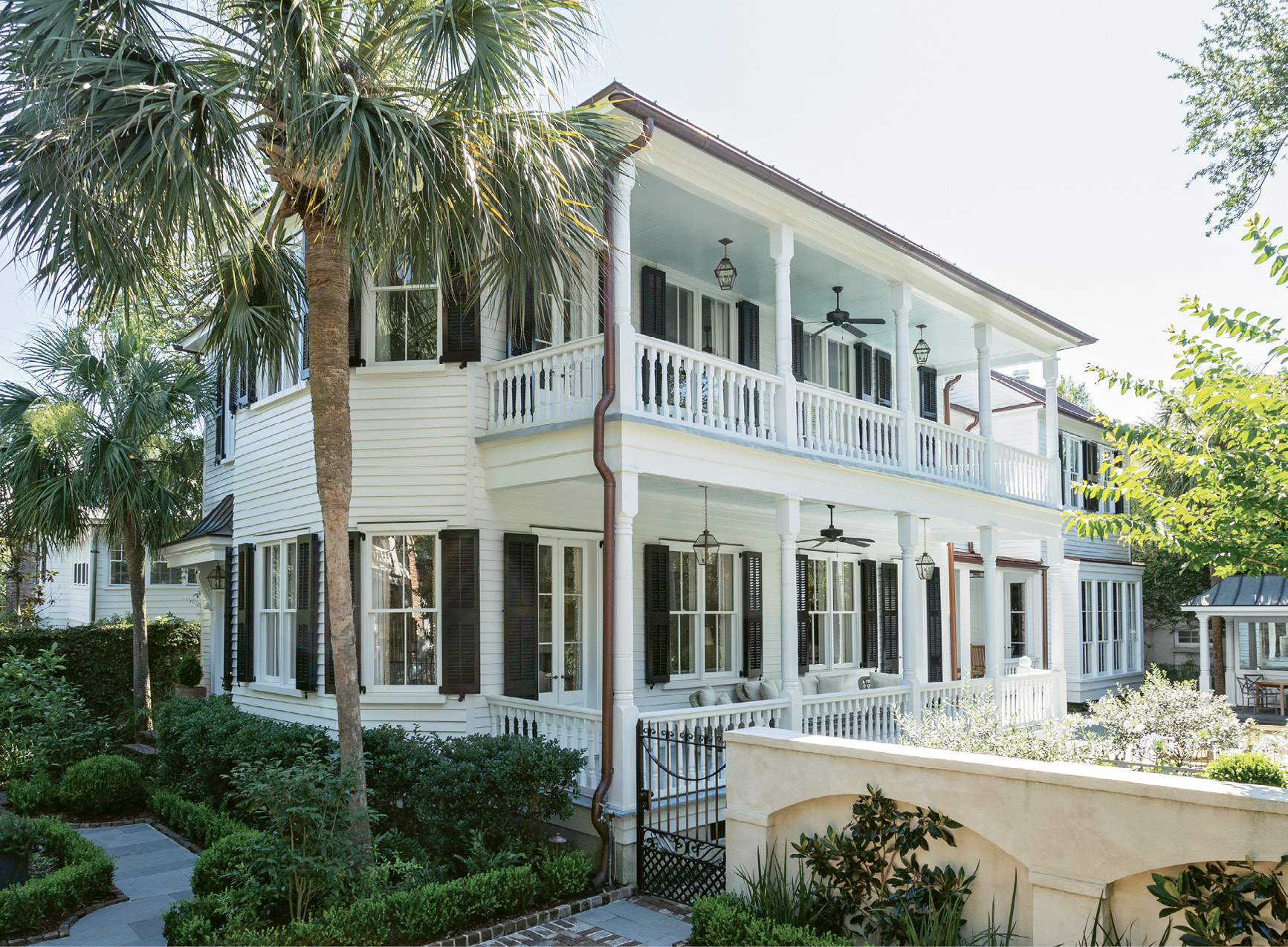 HOME AWAY FROM HOME: Picturesque piazzas and palm trees formed the Charleston vacation home ideals of a couple from Omaha looking for a winter retreat. Following an extensive renovation by Beau Clowney Architects and Tupper Builders, the century-old, late-Victorian charmer was ready for its new family.
