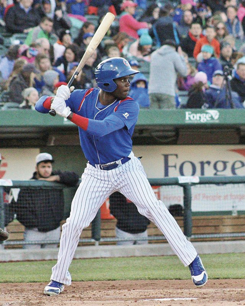At bat for the Chicago Cubs, where he played for their minor league affiliate for two seasons.