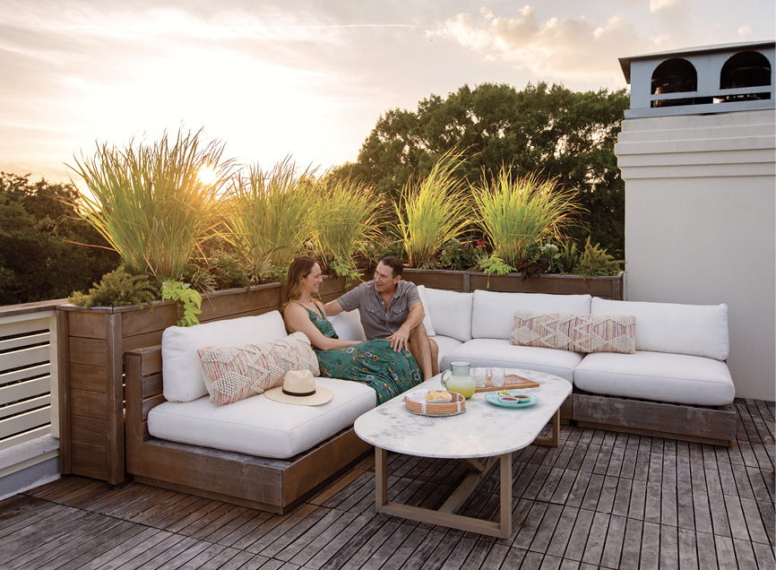 """Happy Hours: Erin and Robert """"Spence"""" Spencer in the rooftop lounge area, one of  two """"must haves"""" when the couple decided to build a new home on their property near the Pitt Street Bridge. It's a primo spot for toasting sunset, especially when Spence is making his signature margaritas."""