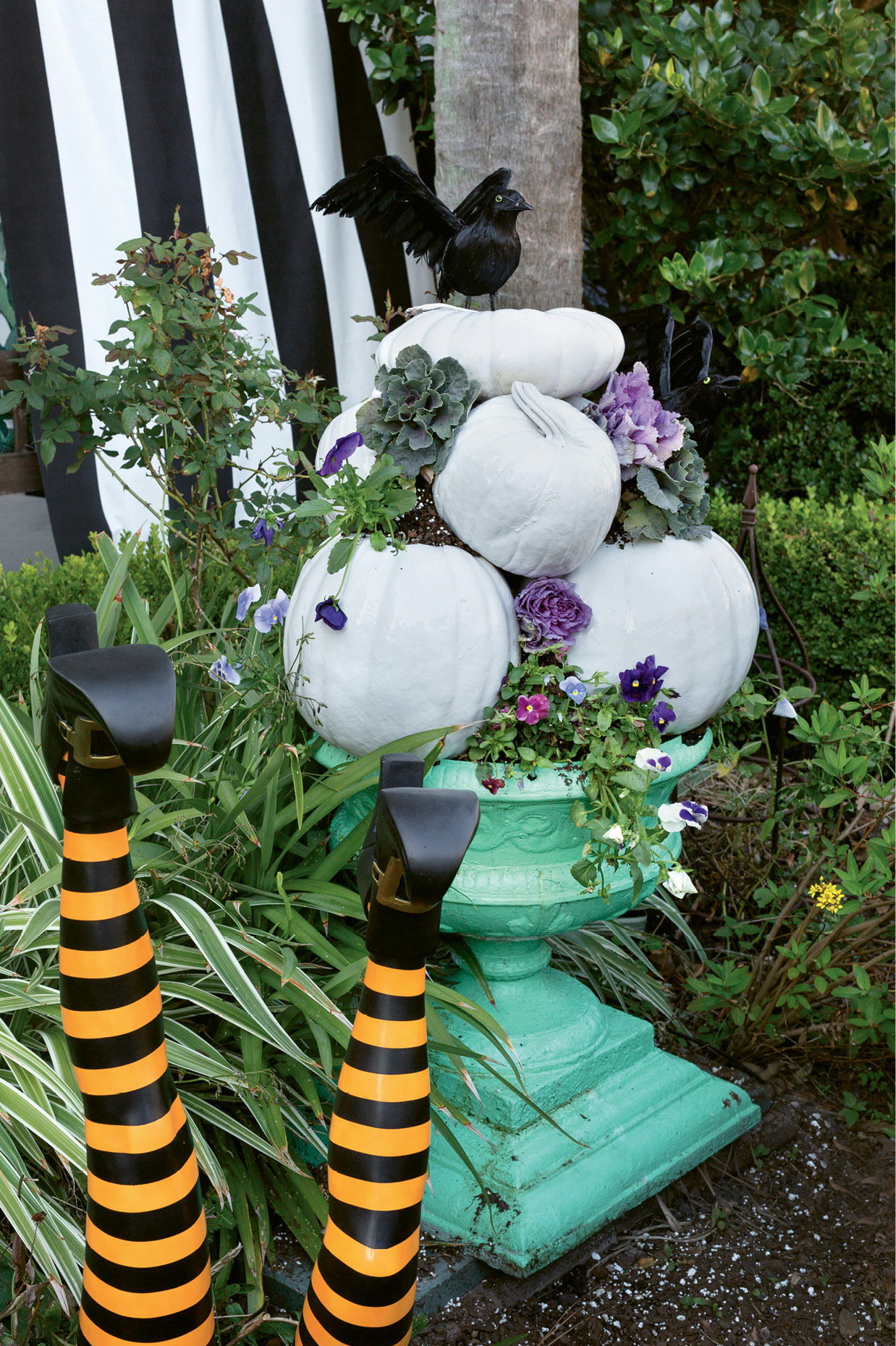 For whimsical garden decorations, fill an urn with potting soil, then balance pumpkins and gourds atop one another, filling the spaces between with more earth.