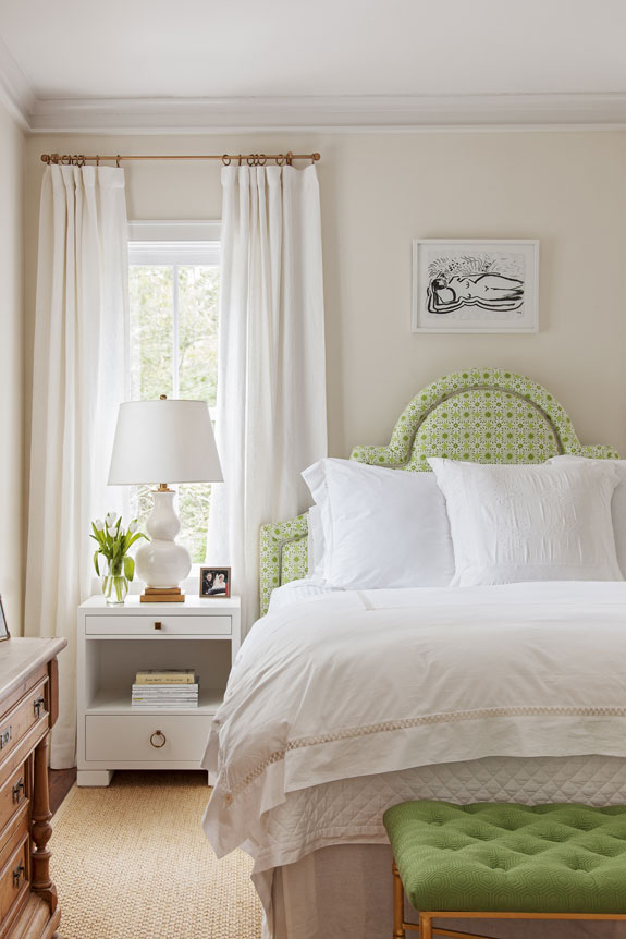 Inspired by views of the adjacent nature preserve, Allison used vibrant green fabrics to upholster a headboard and bench for the master bedroom.
