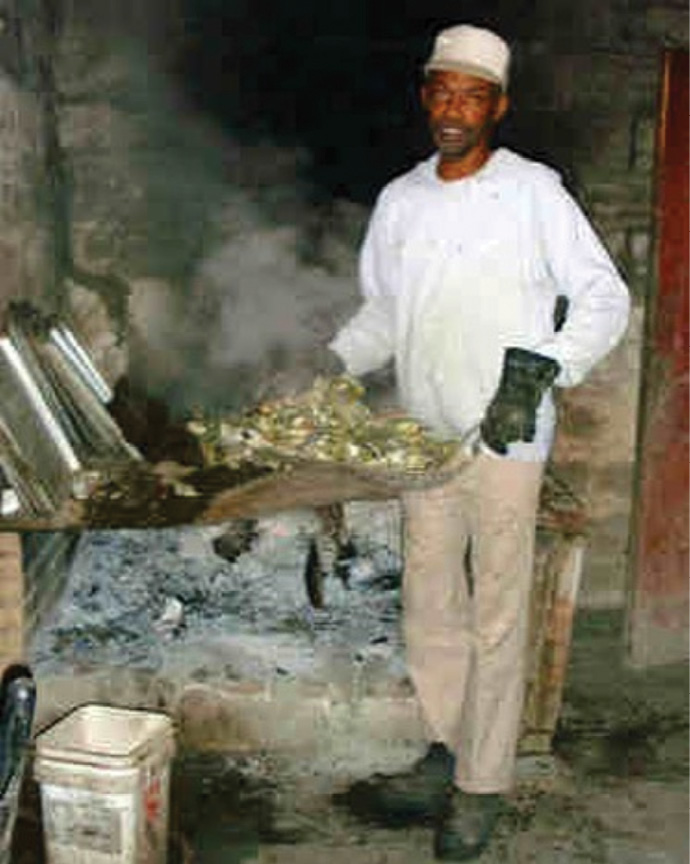Dedicated oyster cook Henry Gilliard stoked fires and roasted clusters in Bowen's special Oyster Room from 1995 to 2011. Known for his sense of humor, he was a crowd favorite. Gilliard died in 2013.