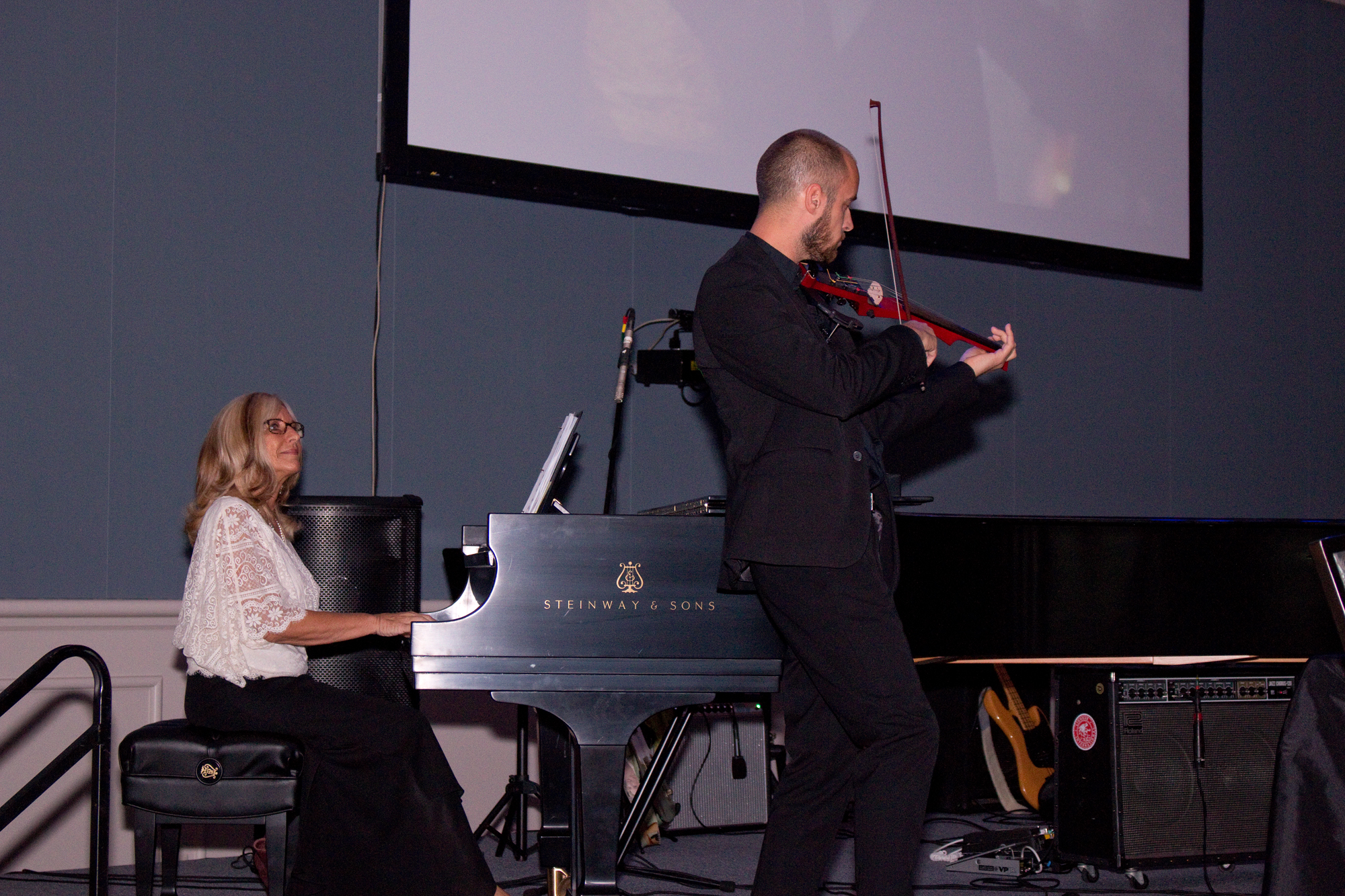 Annette Cantrell Martin from Steinway Piano Gallery of Charleston and electric violinist Peter Kiral kicked off the lineup of entertainment, performing '70s classics.