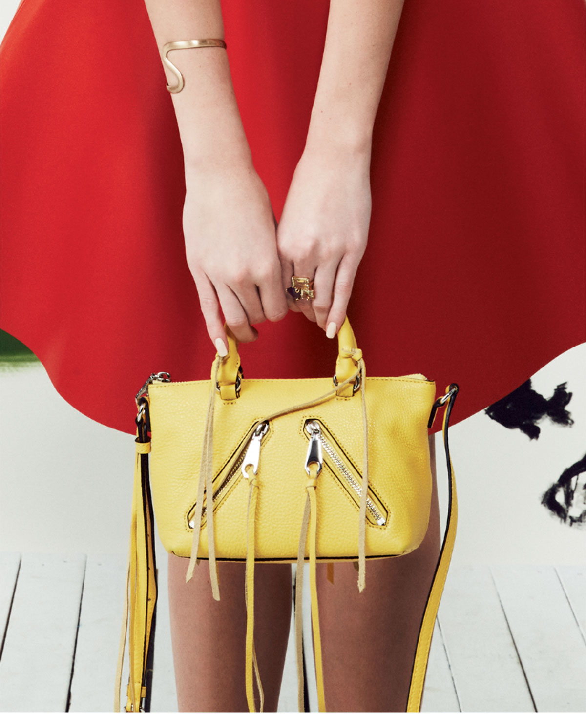 "Rebecca Minkoff ""Micro Moto Satchel"" in ""sunshine,"" $195 at Shoes on King; Golden Stella brushed gold bracelet, $132 at Beckett Boutique; and 14K gold and vermeil lemon quartz cluster cocktail ring, $265 at Croghan's Jewel Box."