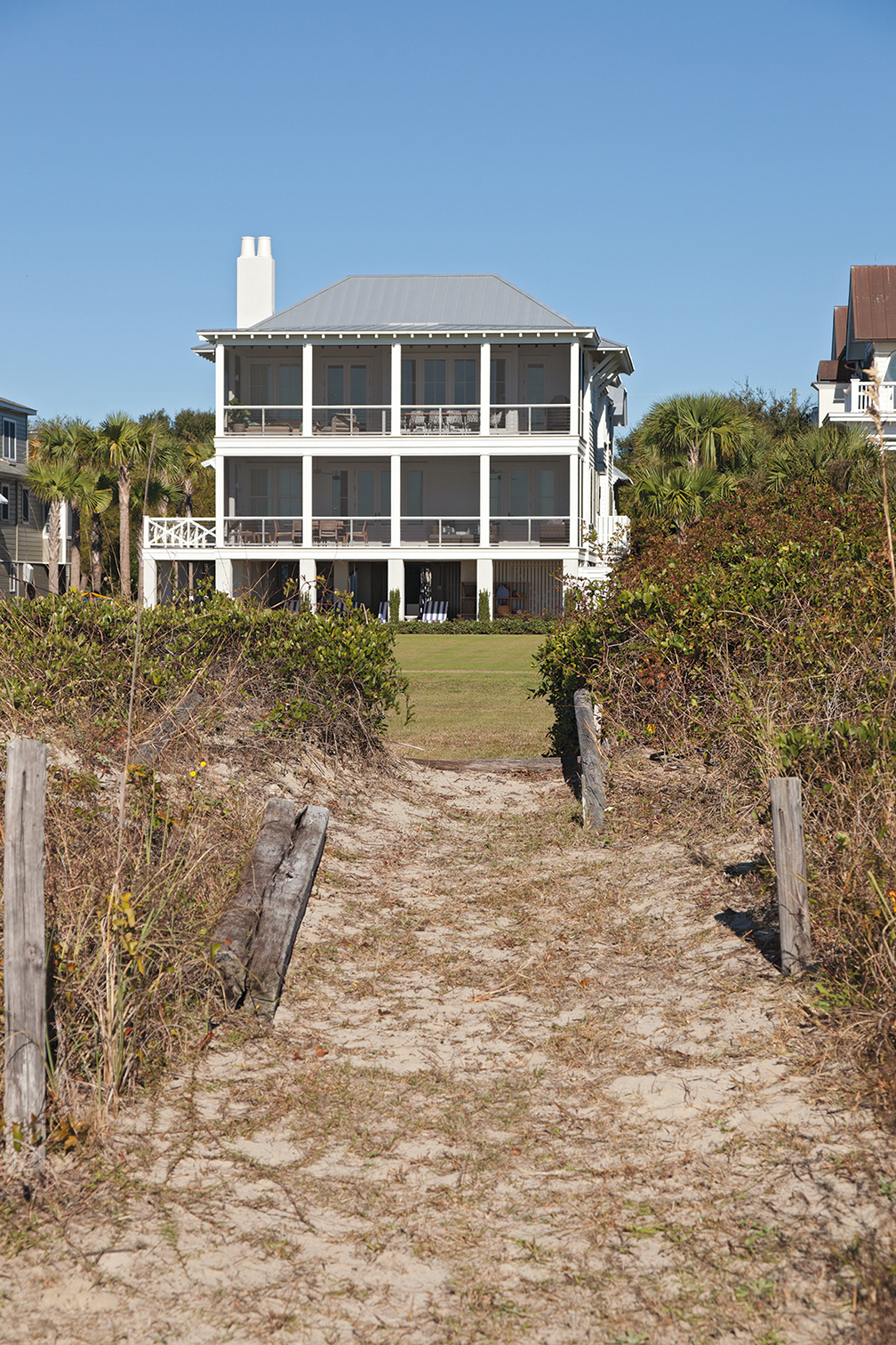 ...while the beachfront façade is a classic, porch-perfect beach house.