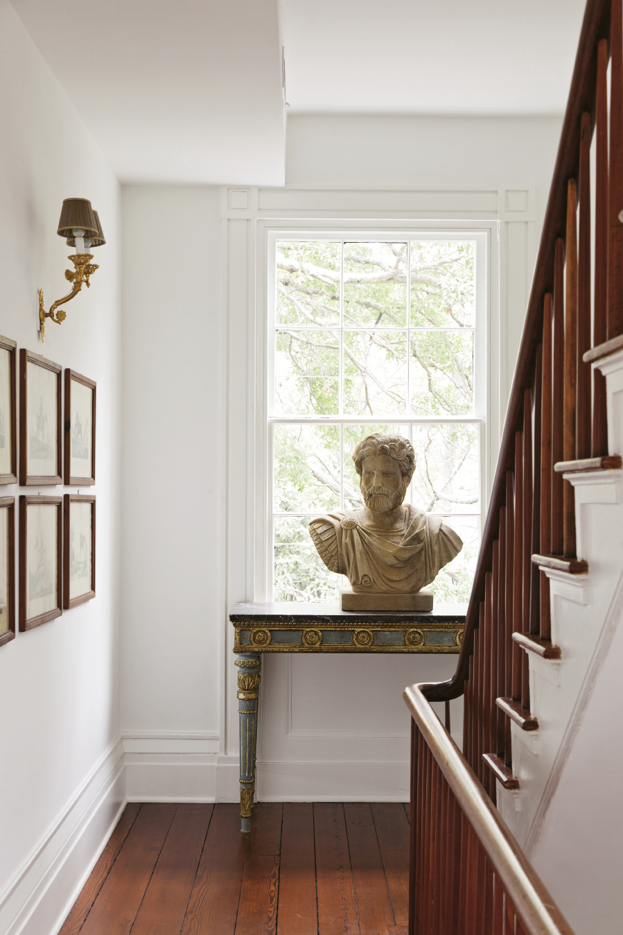 HEIRLOOM IMPORTS A bust of a Roman commander sits on a gilded 18th-century table in the second-floor hallway.