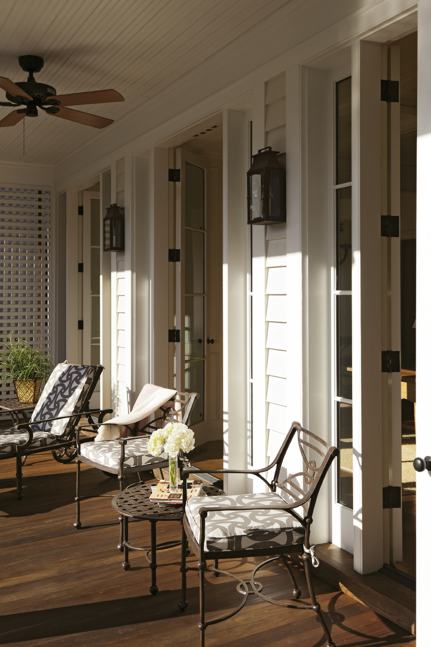 Two porches along the back of the home overlook the personal haven.