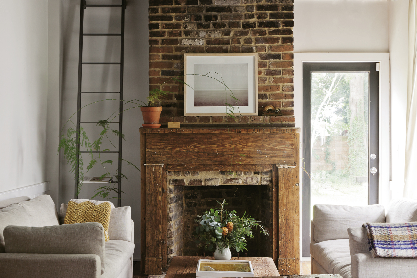 : Neutral furnishings and fresh greens establish a natural palette in the living room (above) that doesn't compete with the simple beauty of the original fireplace. In the adjacent dining area