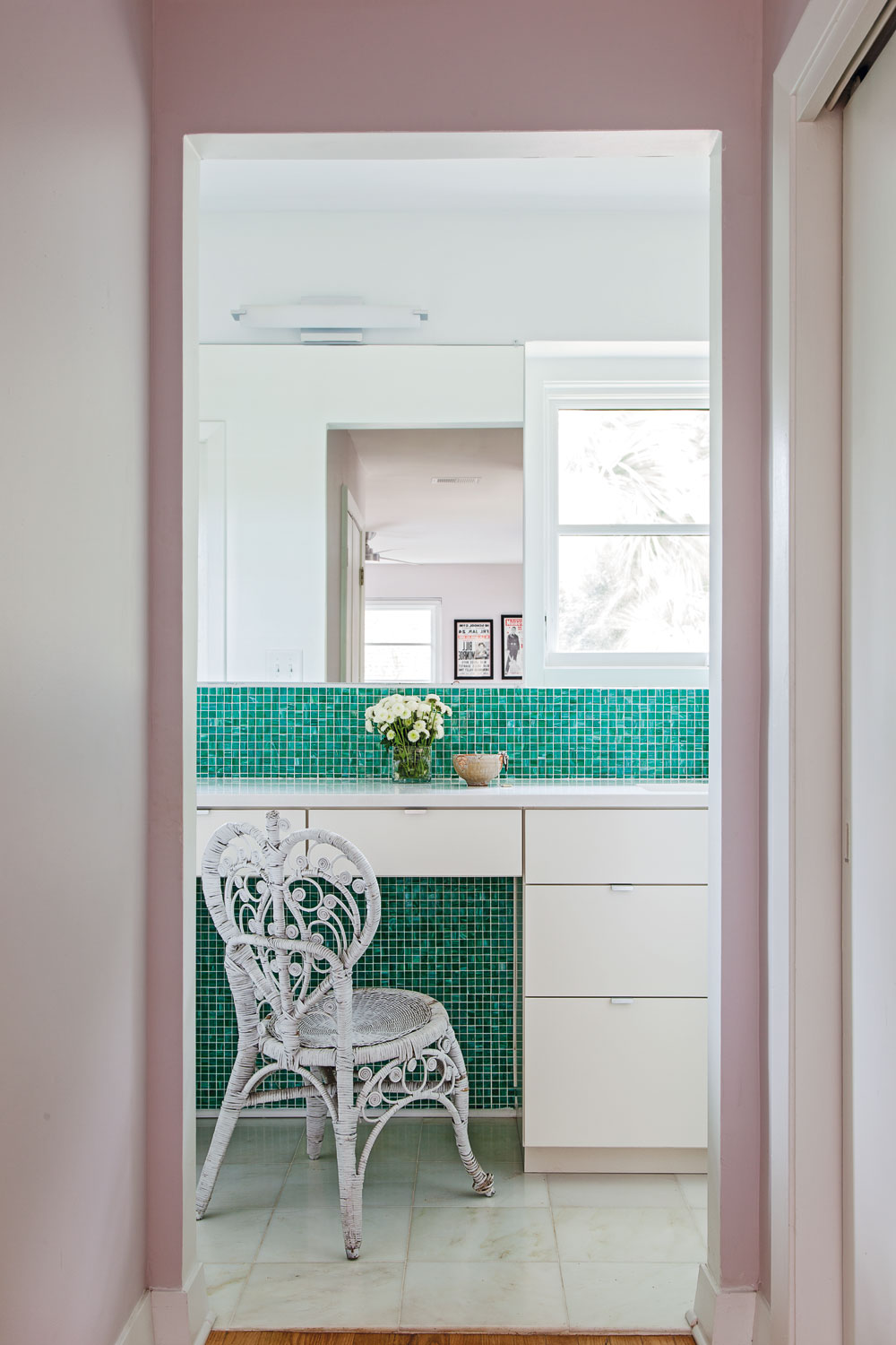 MASTER SPLASH: Green glass tiles contrast beautifully against the contemporary white vanity.