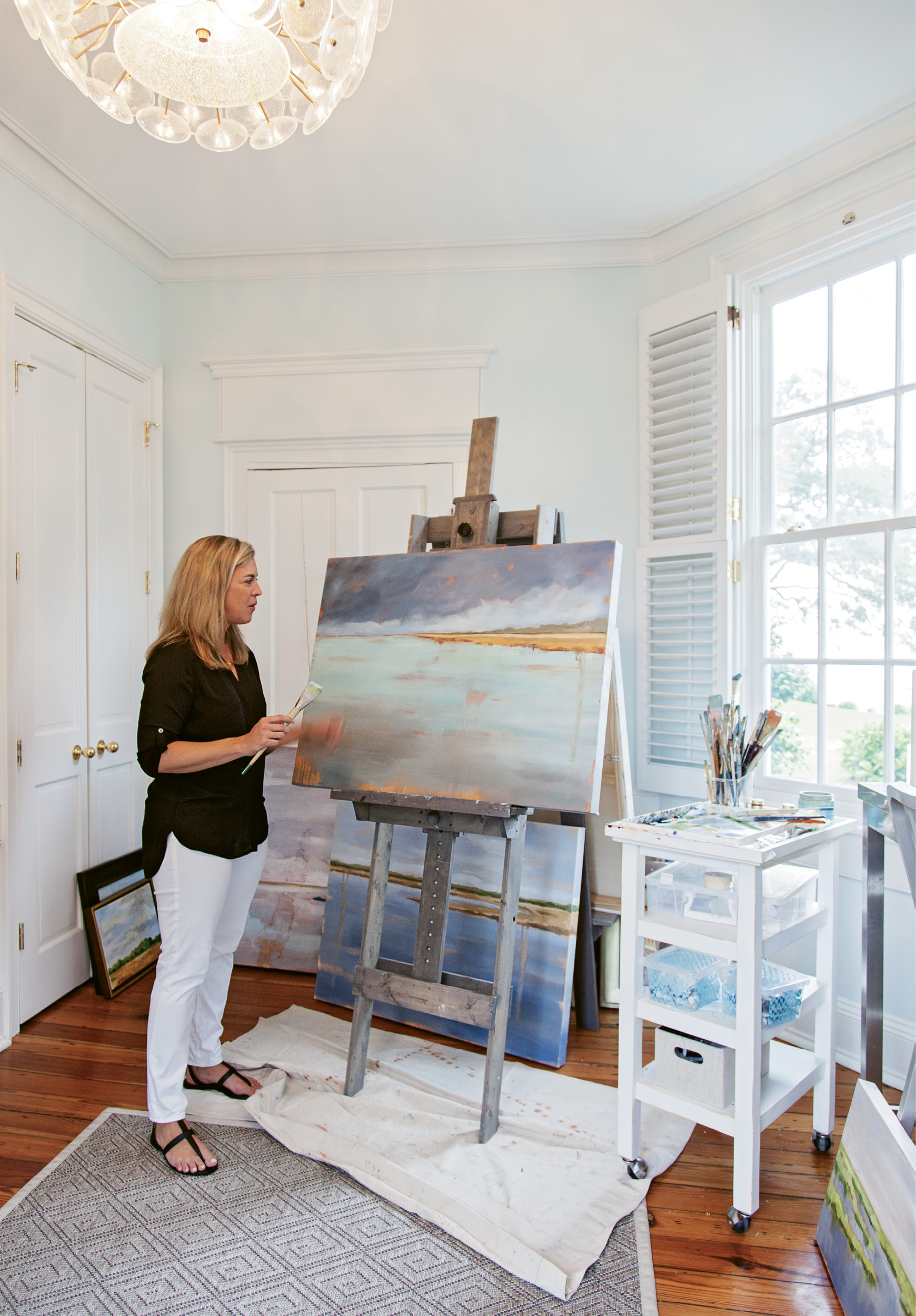 The breathtaking harbor view from Shannon's airy studio window provides the Lowcountry native with ever-evolving inspiration for her abstract landscape paintings, which are available through the Charleston Artist Collective.