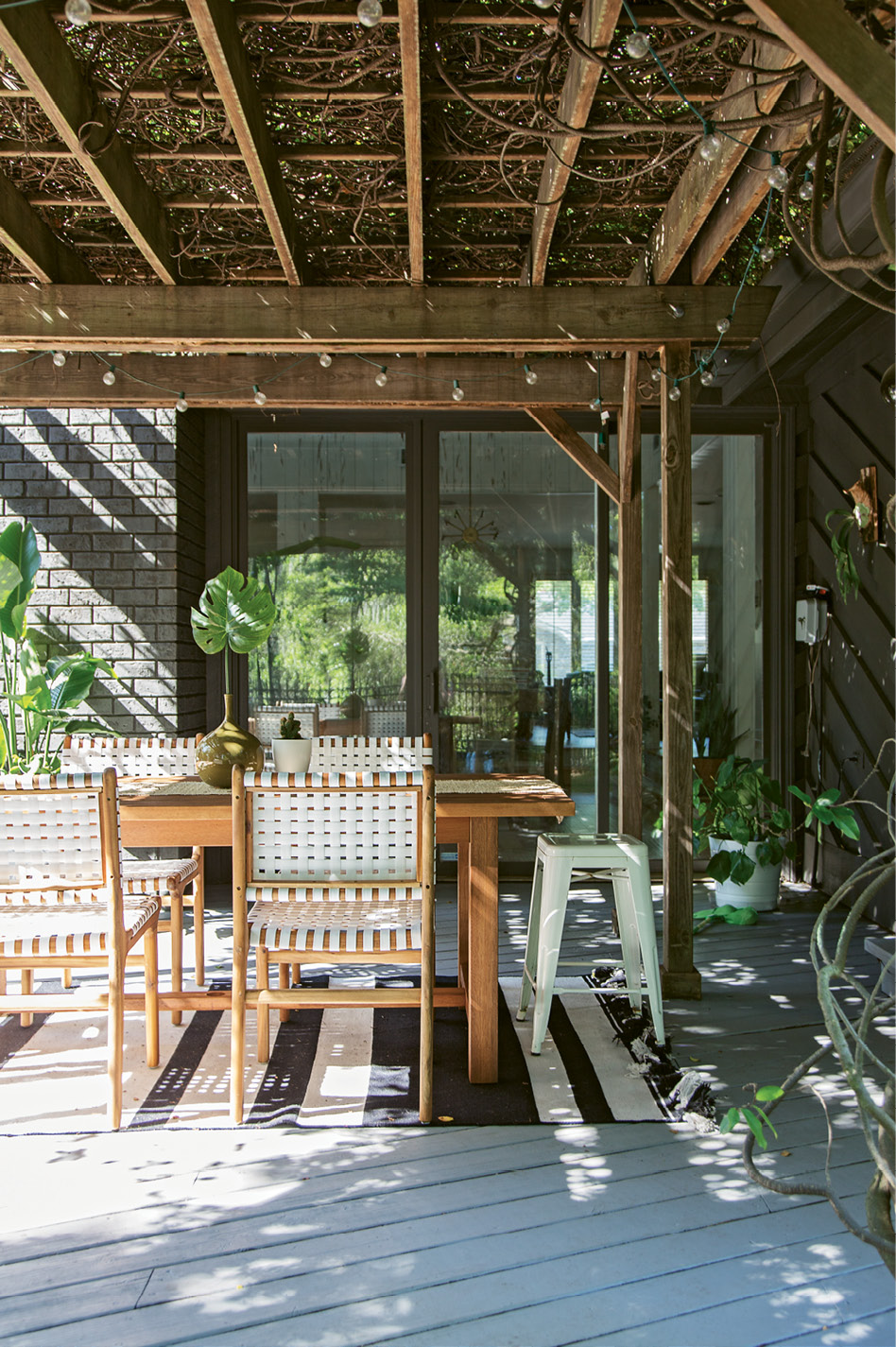 BACKYARD BLISS: Erin's studio opens up onto the back deck; when the work day is done, she, Creighton, and the kids head to this spot for family dinners and dance parties.