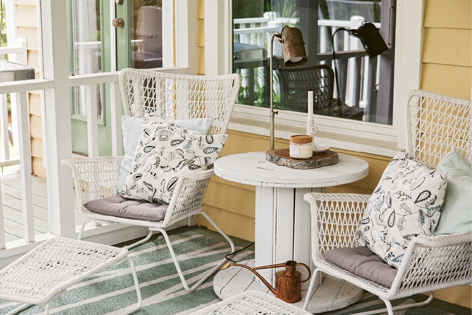 IKEA chairs and a side table fashioned from an upcycled electric spool make for another inviting outdoor nook