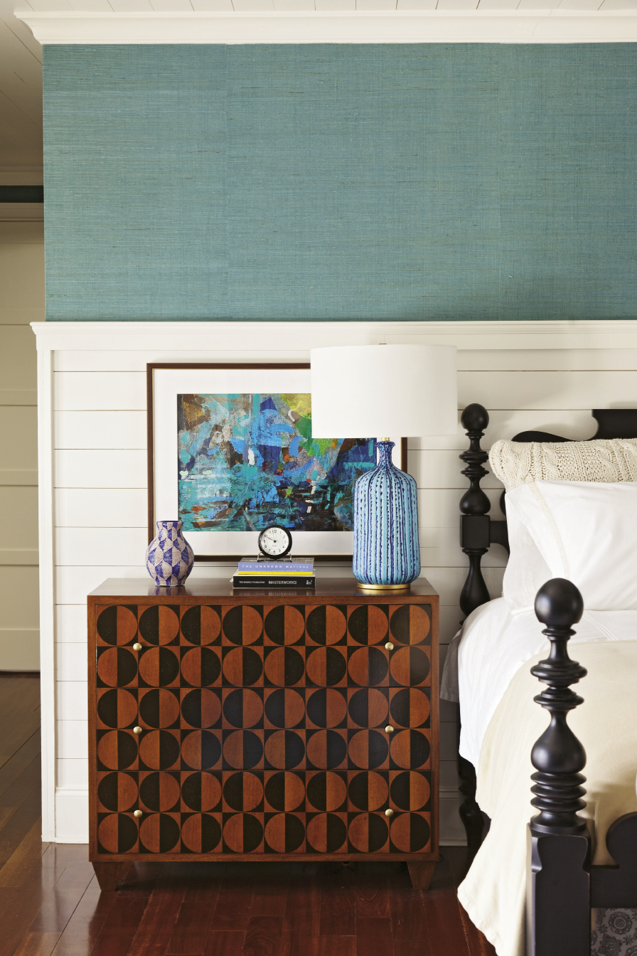 Walnut and mahogany bureaus add graphic punch in the master bedroom.