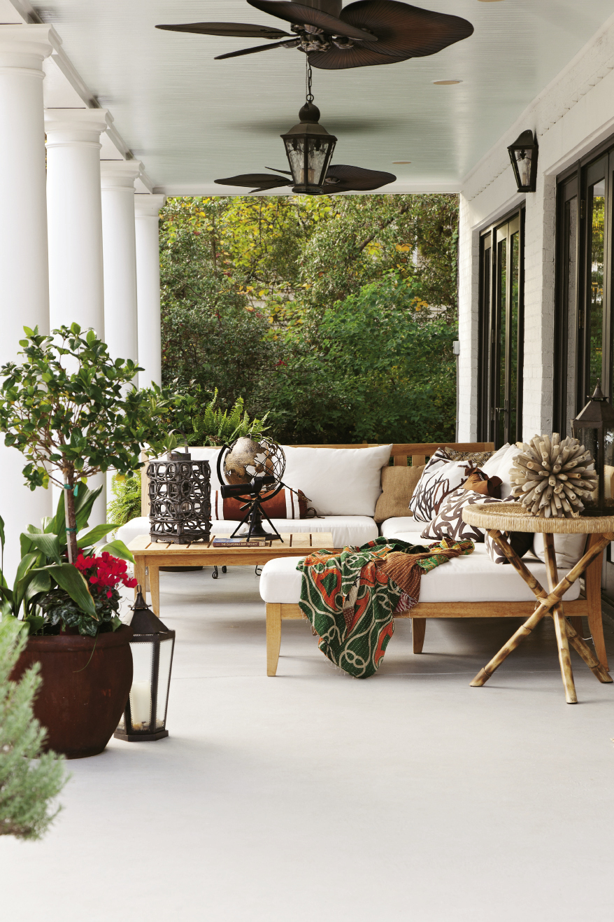 Chill Out: Homeowner Jennifer Moriarty fashioned this creekside veranda for year-round lounging white white canvas.