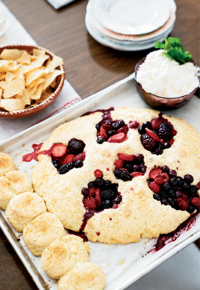 The berry-filled biscuits are served with whipped cream (above), but topping them with vanilla ice cream is also delicious.
