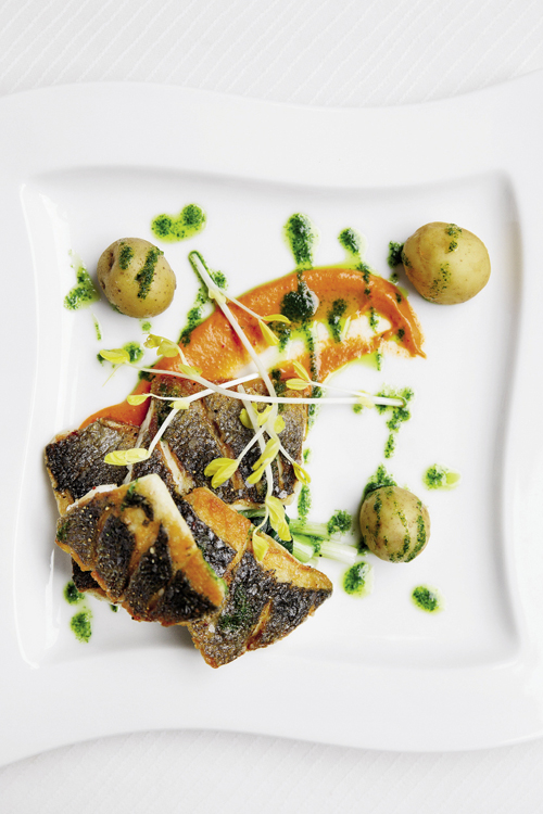 "The ""pure"" section of the menu offers lighter fare, like this branzino with romesco and parsley-garlic puree."