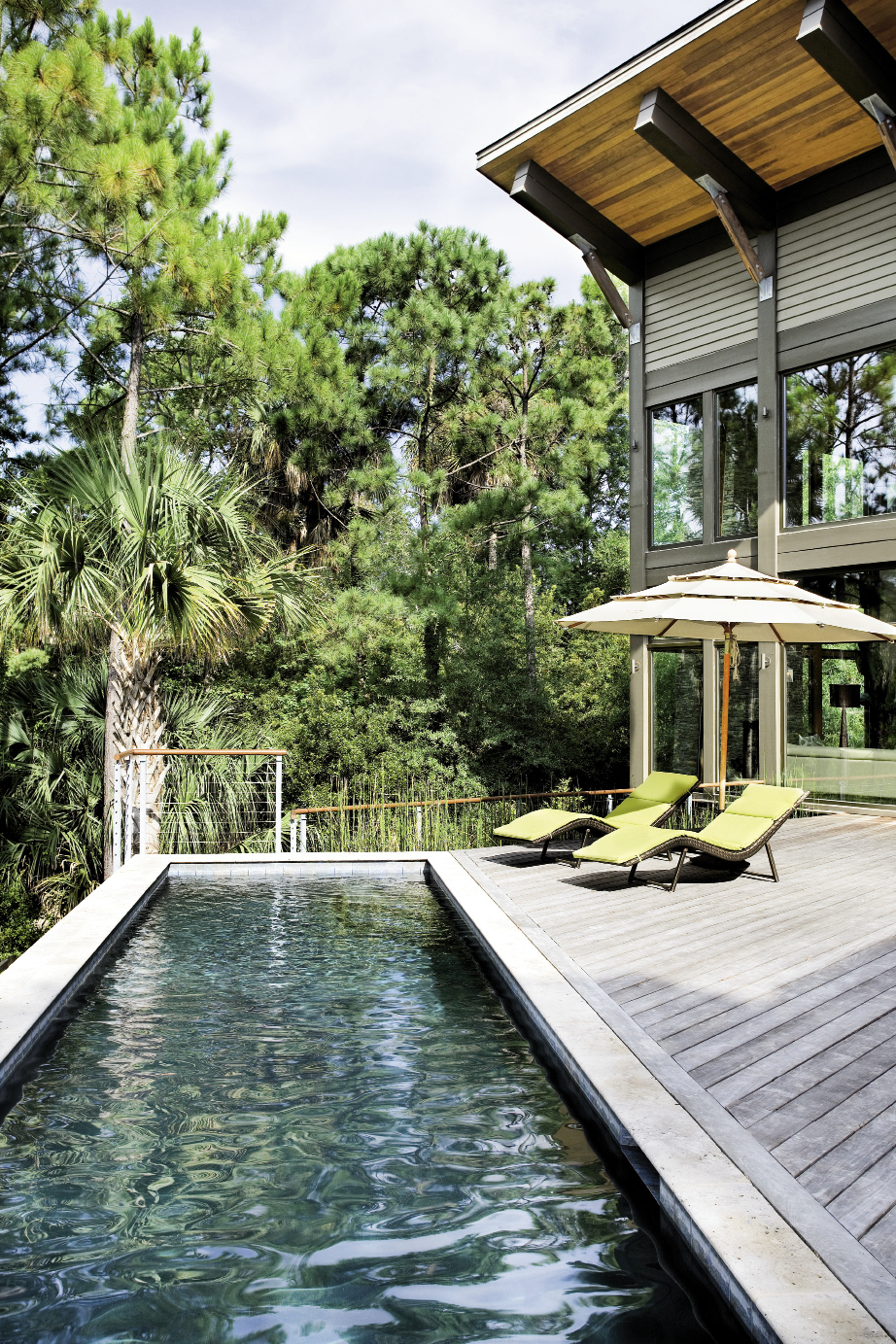 A 30-foot lap pool stretches across the expansive ipé deck and overlooks a quiet lagoon