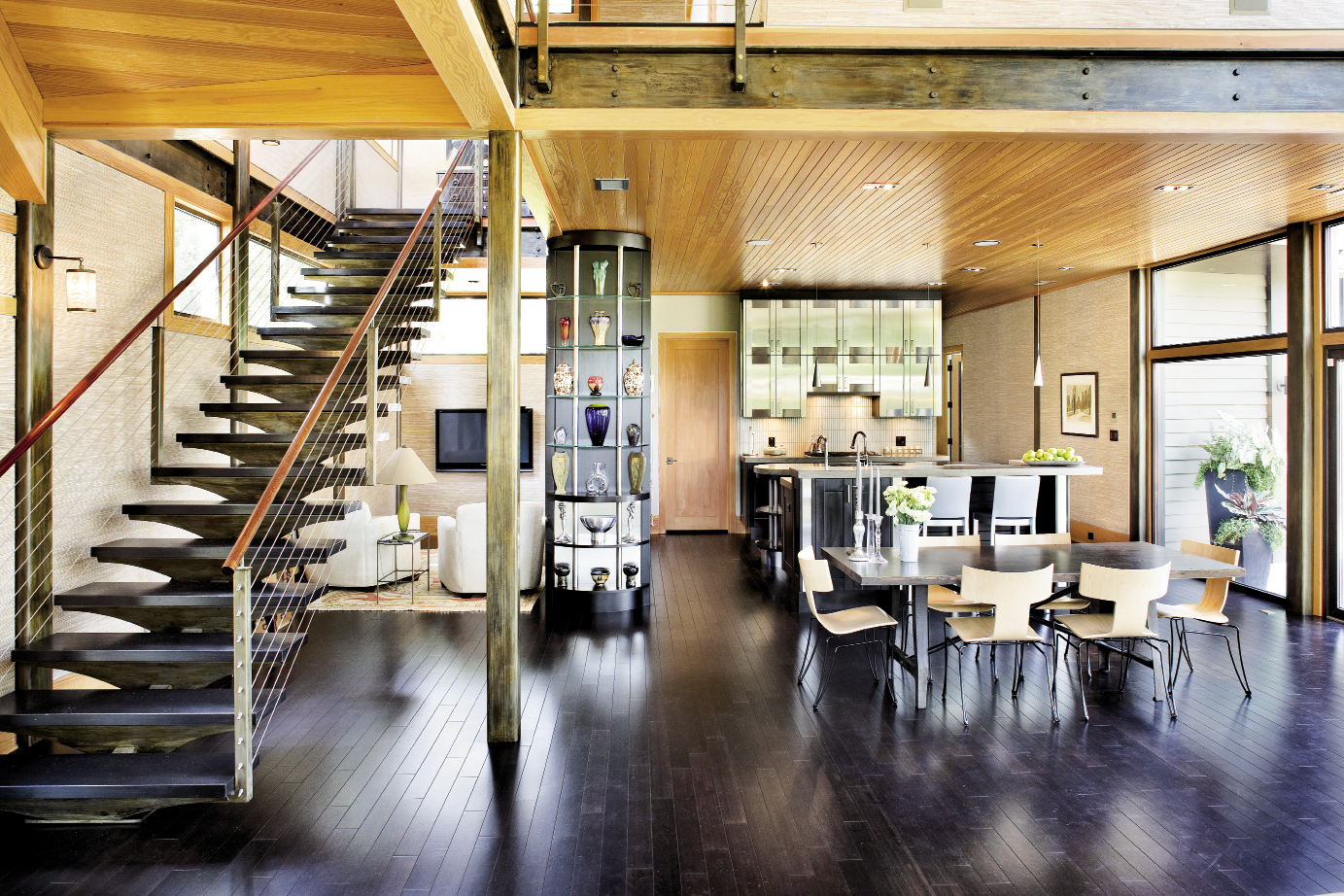 Cypress ceiling paneling, bamboo floors, stacked stone, and earthy grasscloth offset the contemporary structure's hard edges.