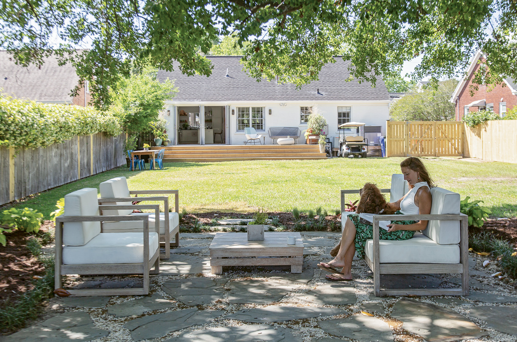 "OUTDOOR OASIS: Two sets of French doors and a sprawling wooden deck add appeal to the rear of the home. But Rachel's work out back has just begun. ""I'm going to have big garden beds on both sides of the yard and plant more trees,"" she says. ""Then dreamland is to have a pool right in line with the patio."""