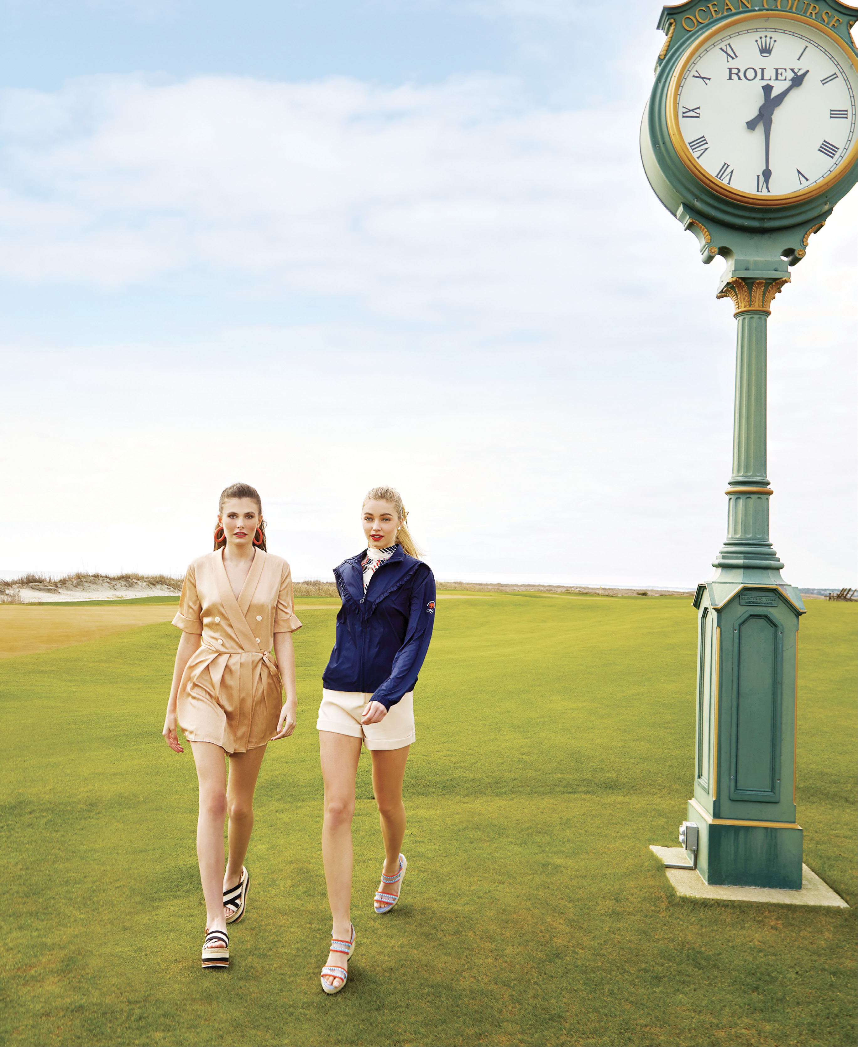"Tee Time: (On Sara, left) Lost + Wander ""High Roller"" romper, $108 at Sapphire Boutique; Ink + Alloy beaded coral hoops, $27 at Out of Hand; Tory Burch platform espadrille sandal, $258 at Gwynn's of Mount Pleasant; (on Maddie, right & opposite) Julie Brown NYC ""Disco Tek"" top, $115 at Out of Hand; Tory Sport ruffle windbreaker, $208 at The Ocean Course at Kiawah Island Pro Shop; ""Luxe"" shorts in ""taupe,"" $72 at Maris DeHart; Little Fish Boateak coin pearl studs, $24 at Woodhouse Day Spa; Castañer ""Xully"" wedge sandals, $345 at Shoes on King"
