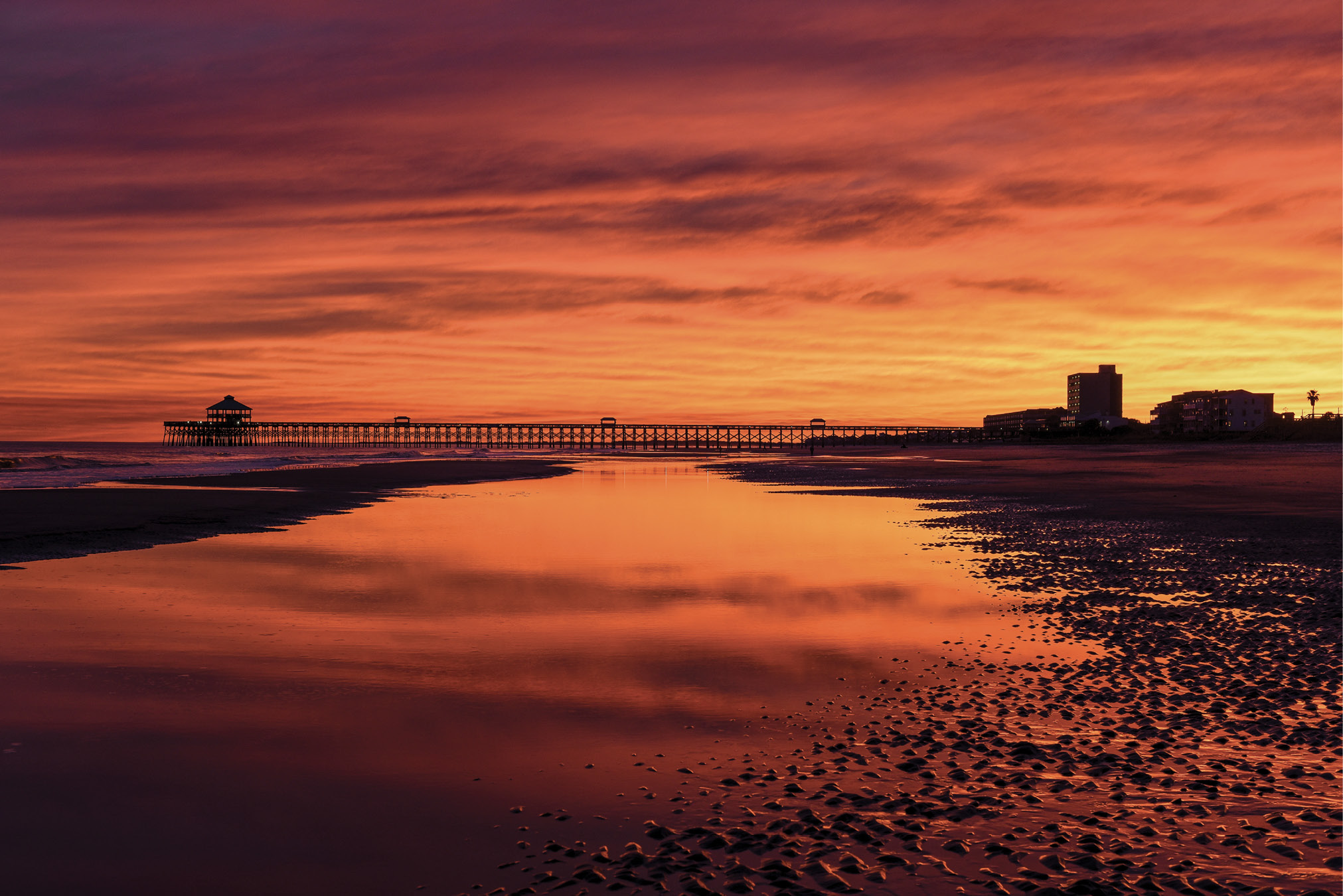 A dramatic sunset at low tide