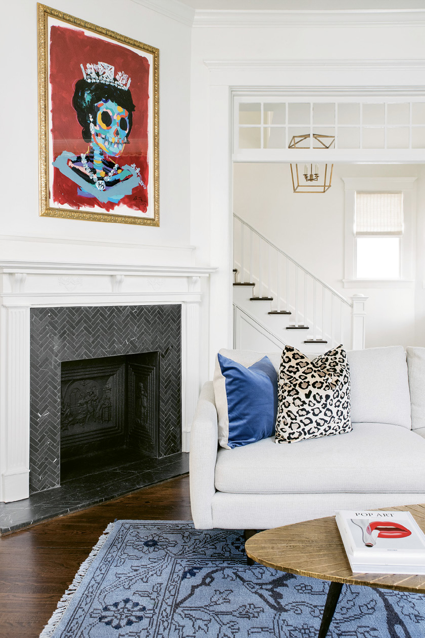 An original painting by Bradley Theodore is the crown jewel of the room.