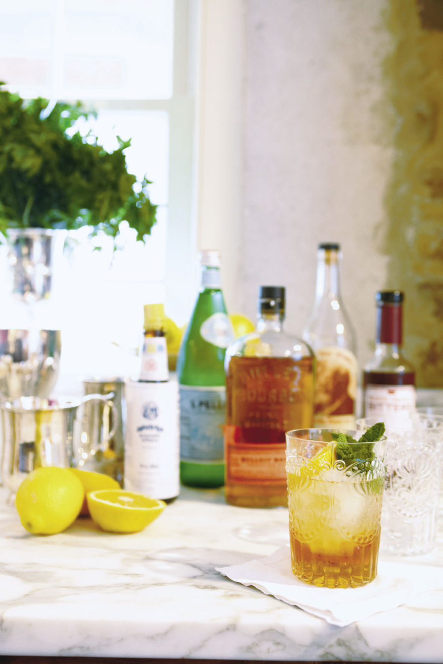 They suggest preparing a signature cocktail or punch for a party, handing guests a drink when they arrive.