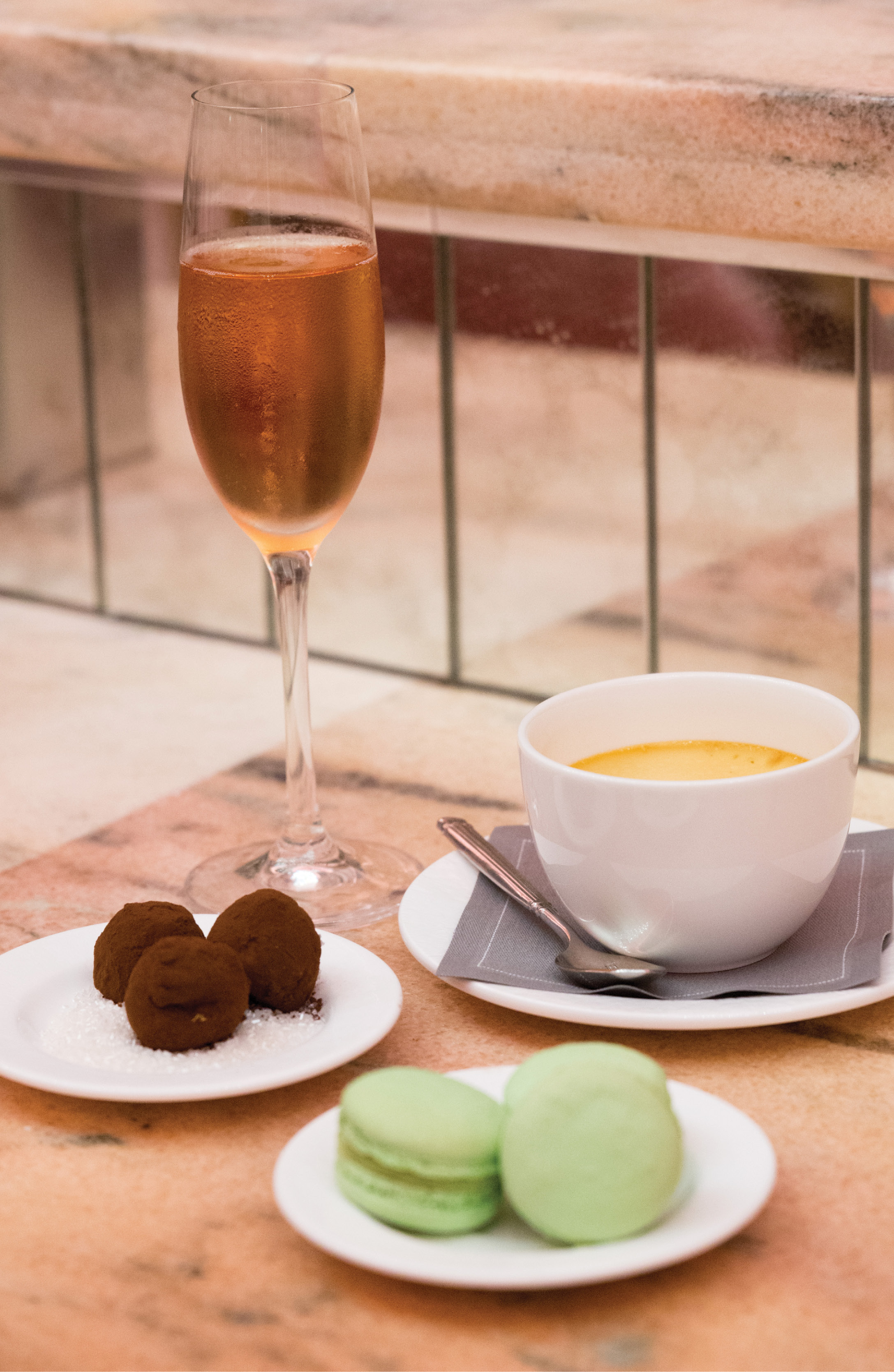 Toast of the Town: Chef Rémy Fünfrock's (inset above) on-menu confections can be enjoyed throughout Hotel Bennett. At champagne bar Camellias, a glass of sparkling rosé makes for a perfect pairing with his sweets.