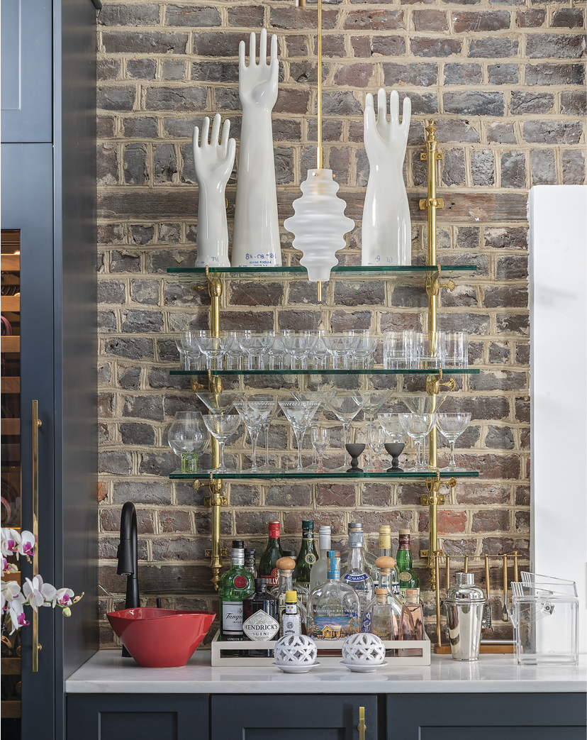 There, a bar adorned with vintage porcelain glove molds provides a spot to procure libations.