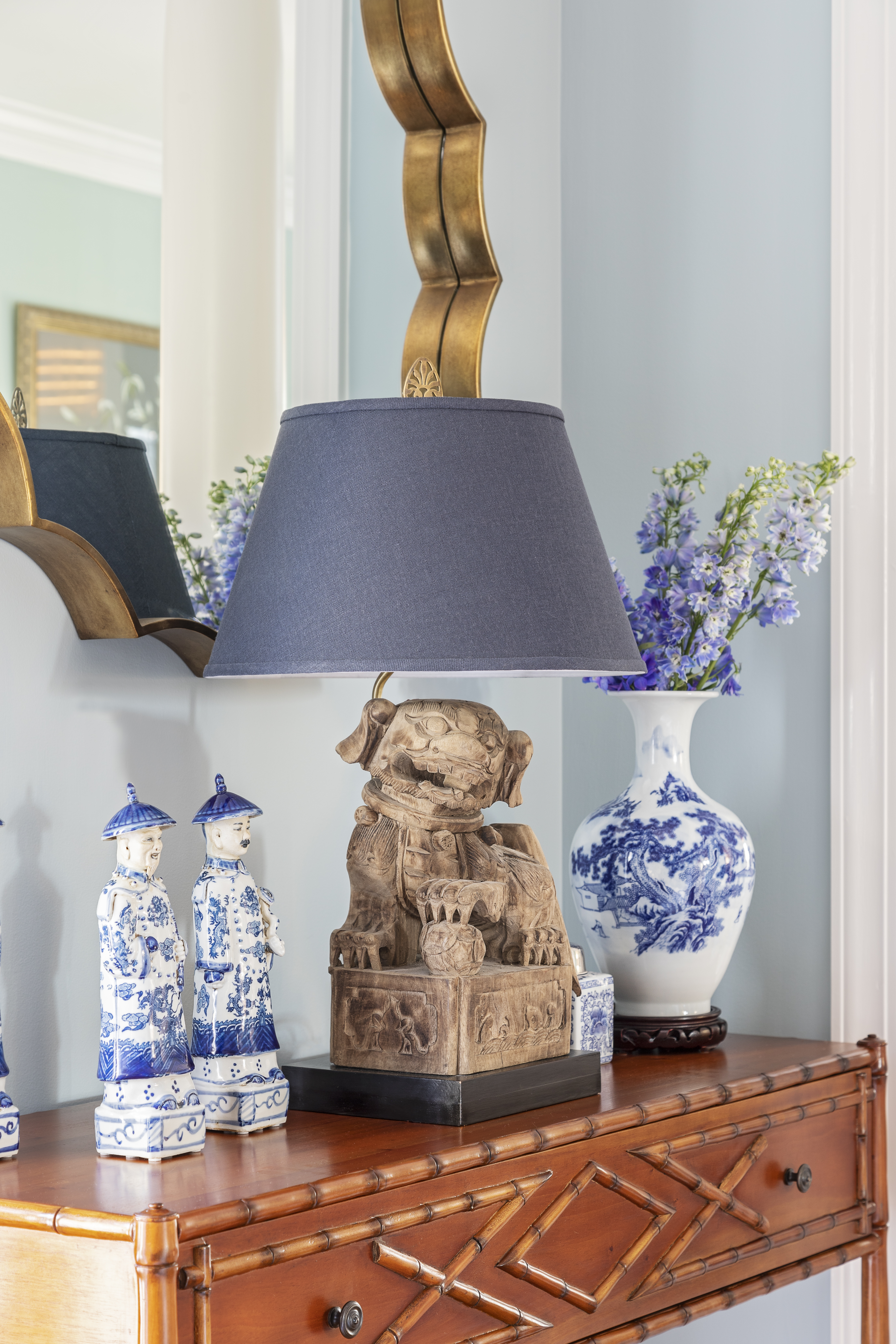 A carved mahogany console table from Bebe & Lenox showcases Peggy's collection of blue and white porcelain.