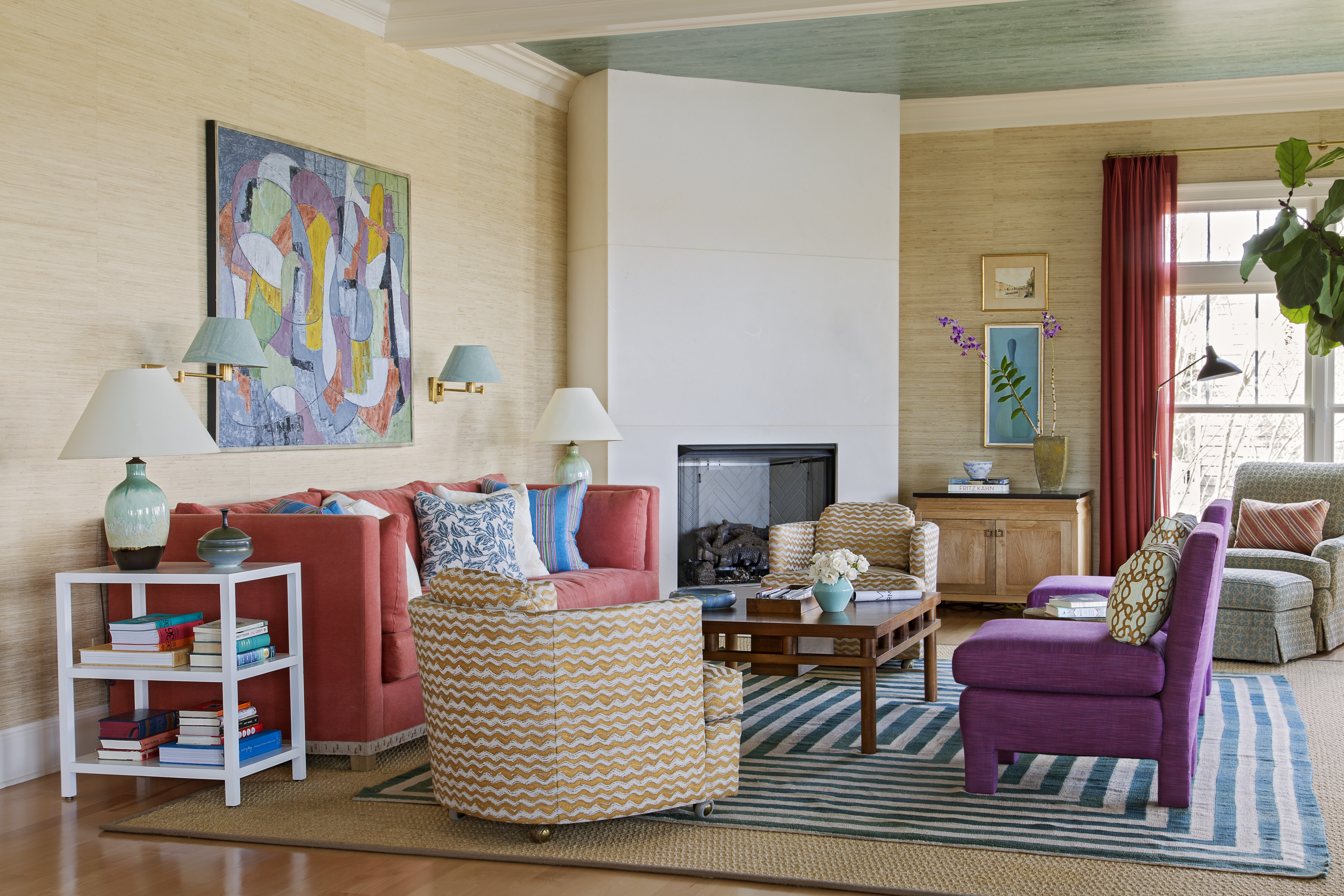 All eyes here are on the water, except for the occasional Netflix watcher. The Ufkeses resolved their difference of opinion on whether to have a TV in the living room by tucking a retractable screen in the custom cabinet by the fireplace, designed thanks to Phil's engineering finesse.