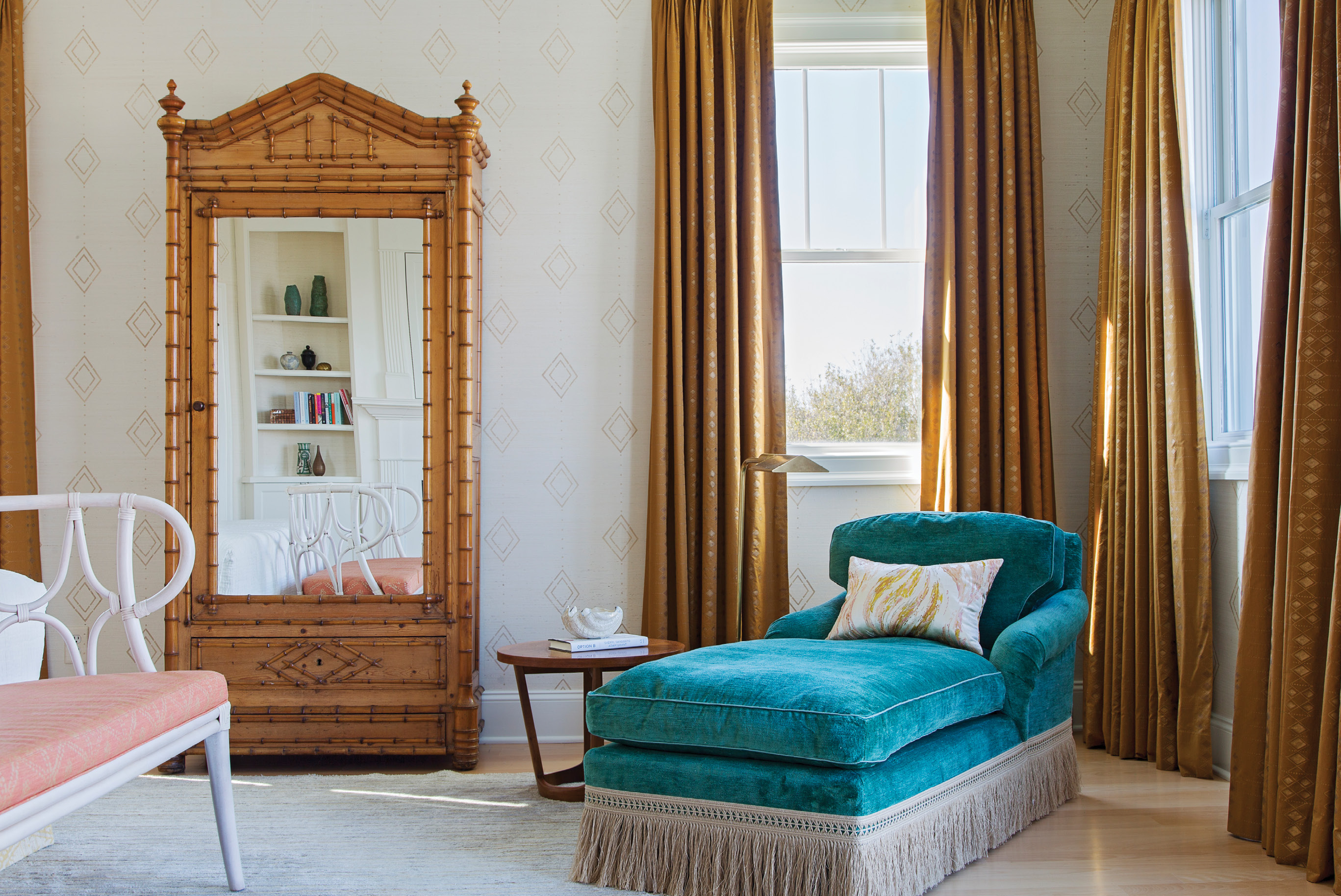 A faux bamboo wardrobe from Fritz Porter, custom drapes in a Muriel Brandolini fabric from Holland & Sherry, and vintage chaise in Pierre Frey velvet add a touch of Hollywood flair and elegant romance.