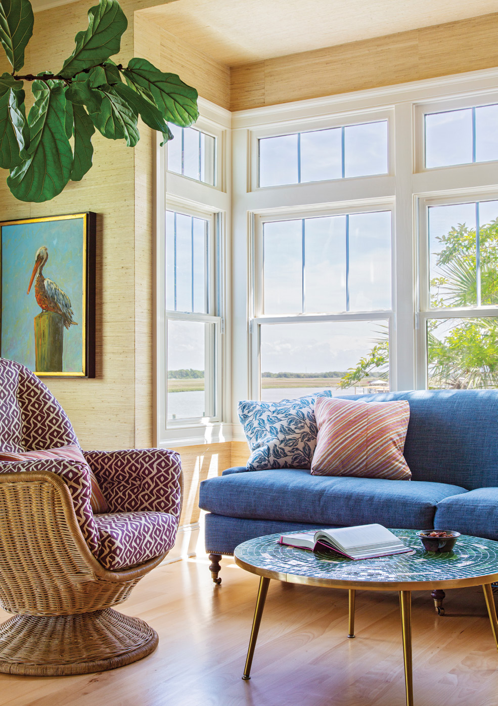 The light-filled sitting area with a blue linen sofa from Jayson Home in Chicago is Rebecca's favorite morning perch.