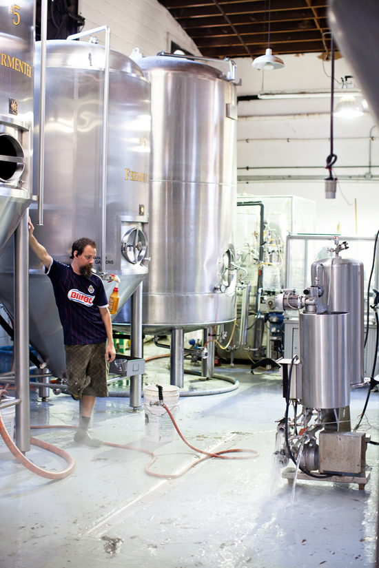 Clint Vick doing the Lord's Work: cleaning the Brew Kettle