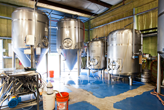 The brew floor, keg washer, two fermenters, and two bright tanks.