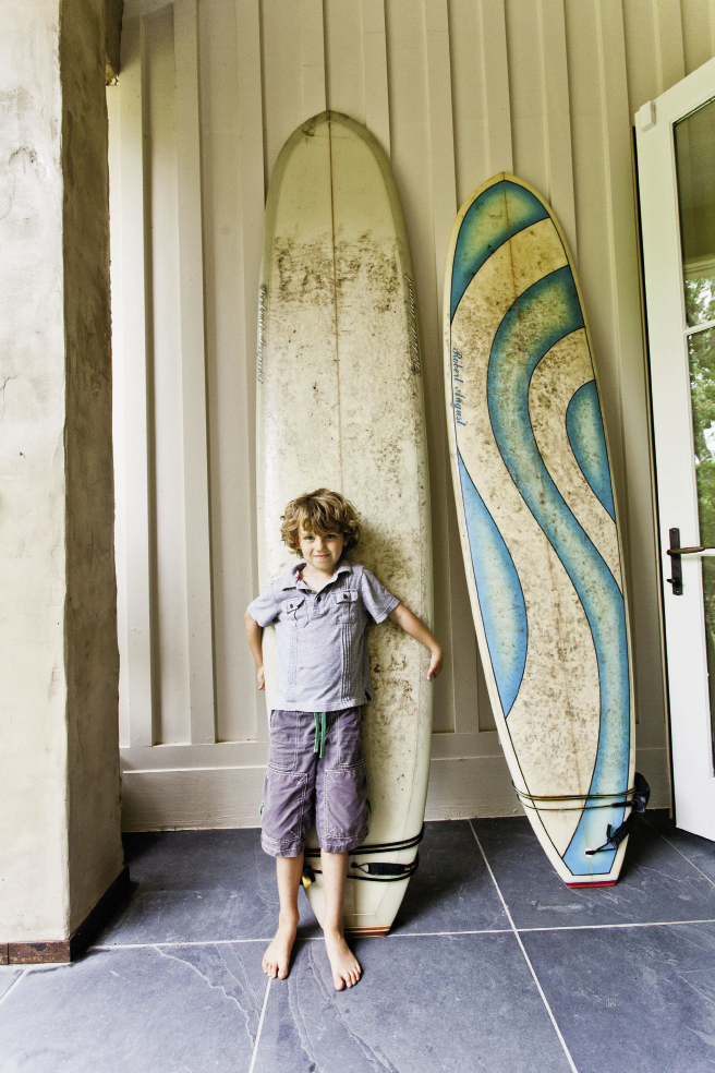 Sometime surf bum Max holds board meetings on the back steps