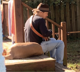 """Porch Strings:  """"I like picking my banjo on the porch with my buddies and Bernie Sanders (that's my pit bull)."""""""
