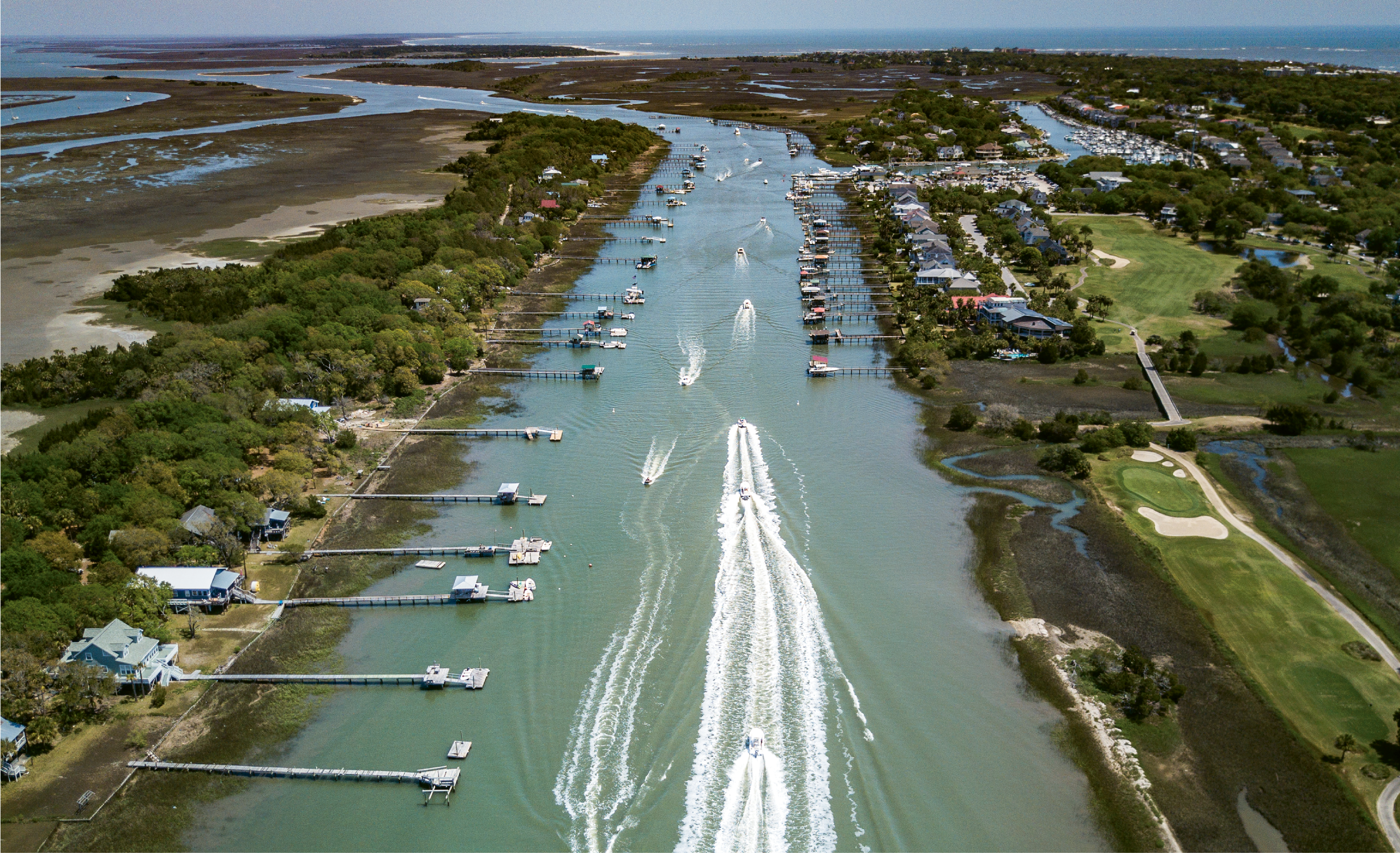 """Easter Weekend Traffic""  {Altitude: 250 feet}  A parade of boats motoring down the Intracoastal Waterway near Isle of Palms"