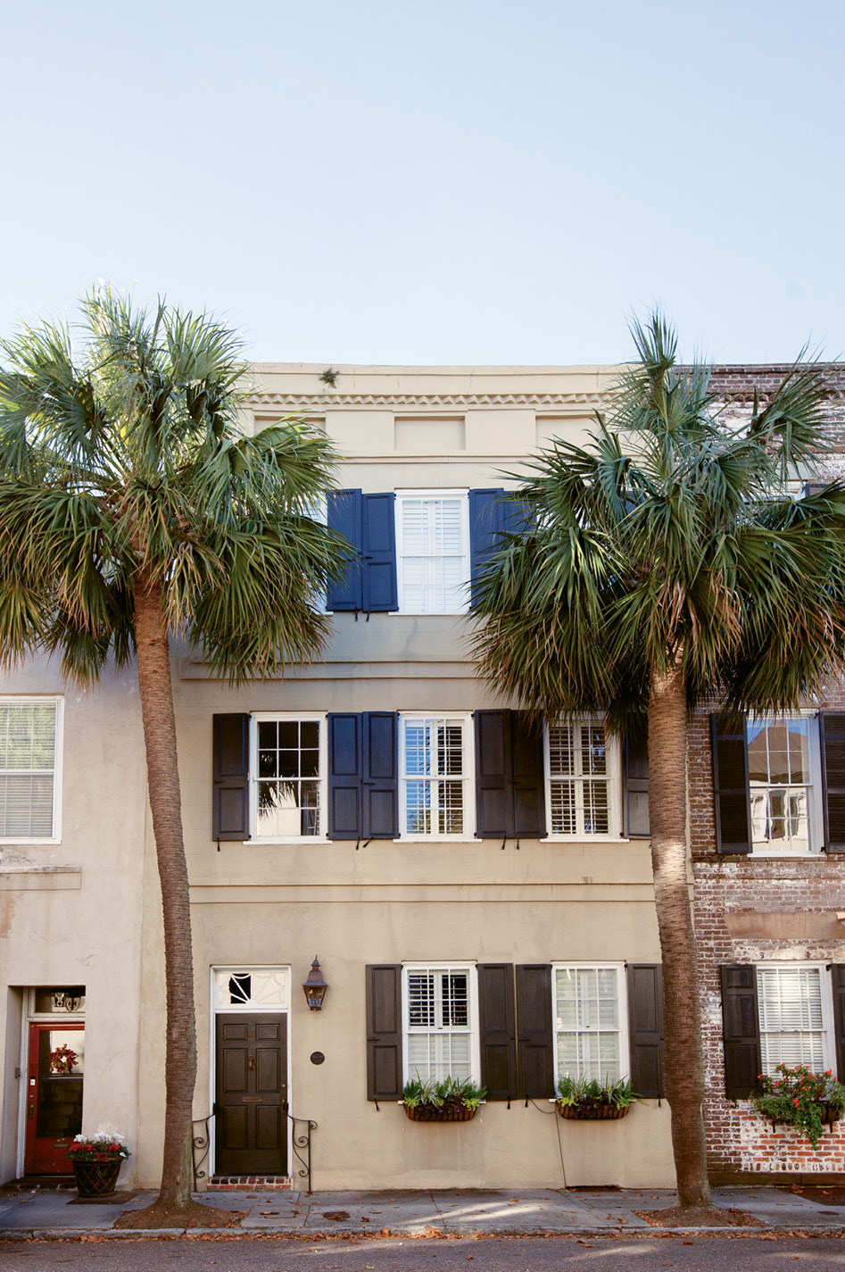 Come On In: Flanked by palmettos, the stucco-over-brick abode is the picture of Charleston charm.