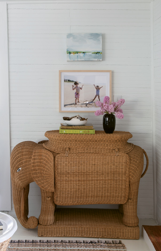 Unique finds, such as the vintage wicker elephant bar and the 1940s driftwood inspired table lamps, dot the home.