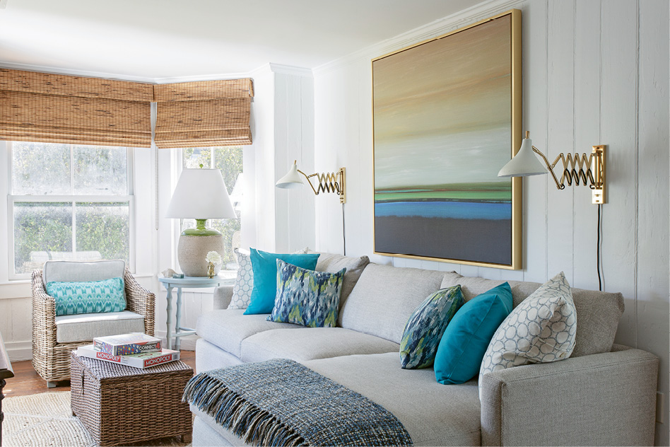 In the family room, colorful pillows from Indigo Market complement the abstract landscape from Wendover Art Group.